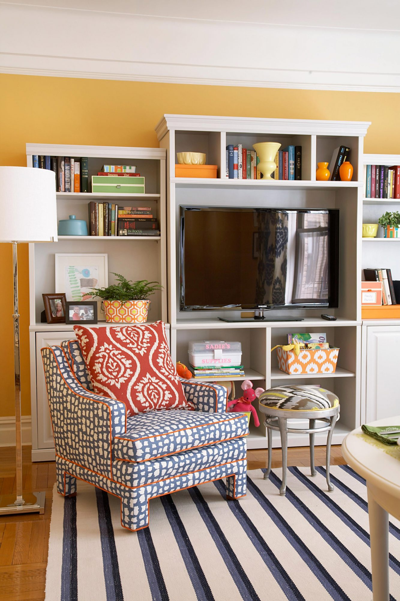 living room with glowing apricot wall color white entertainment center