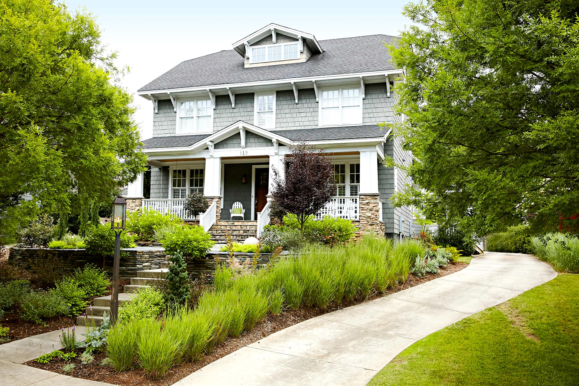 Gray house with garden front yard