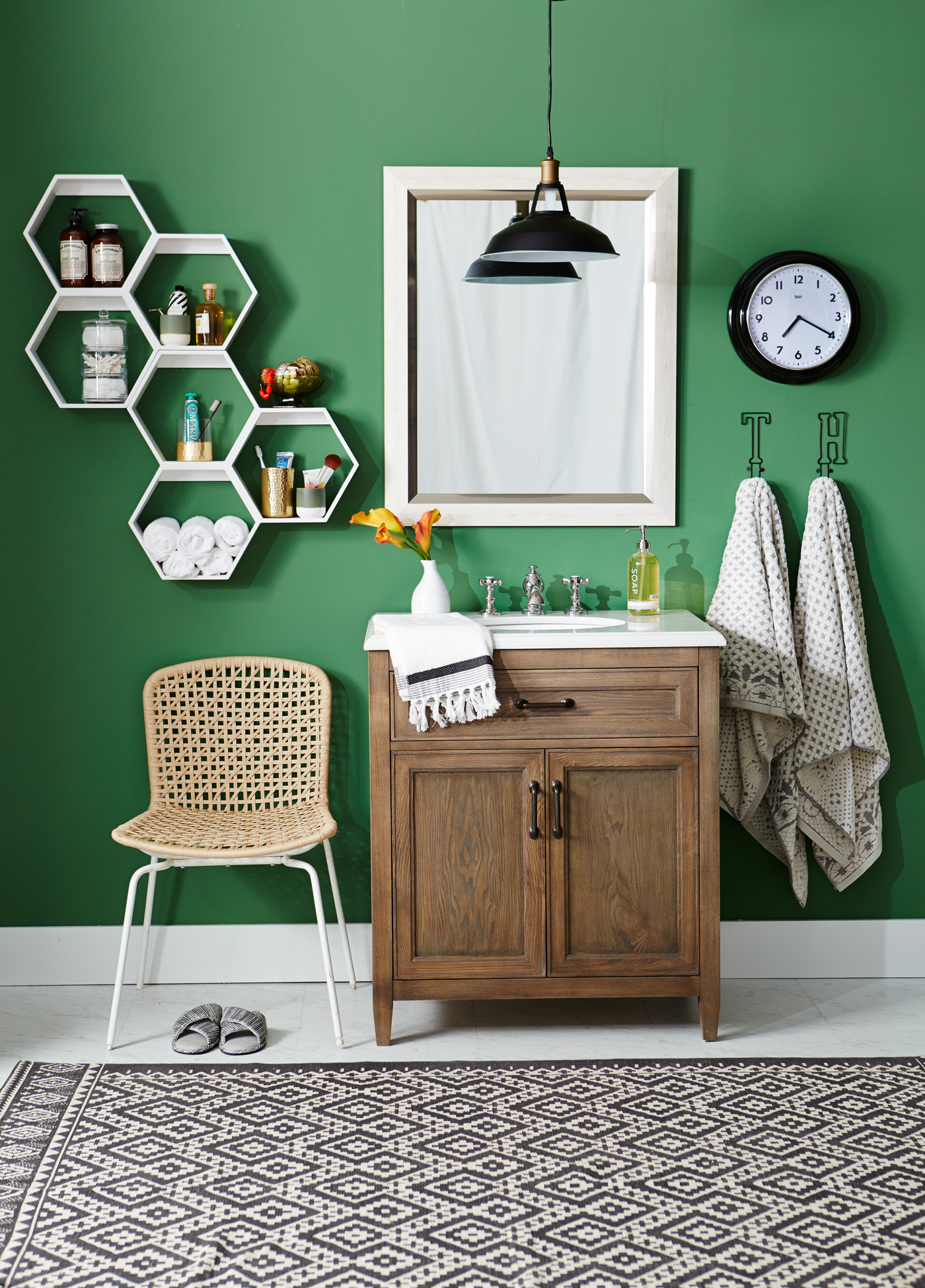 green bathroom with white octagon shelving small sink vanity