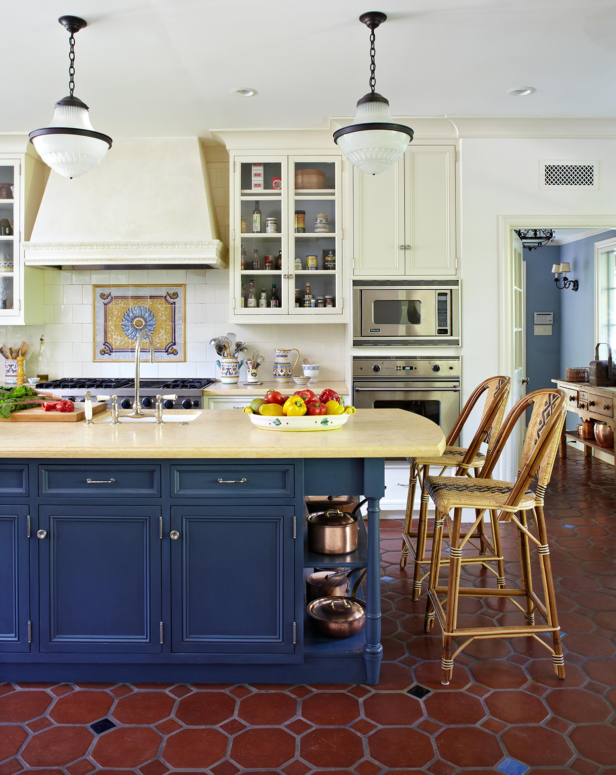 kitchen with blue painted island