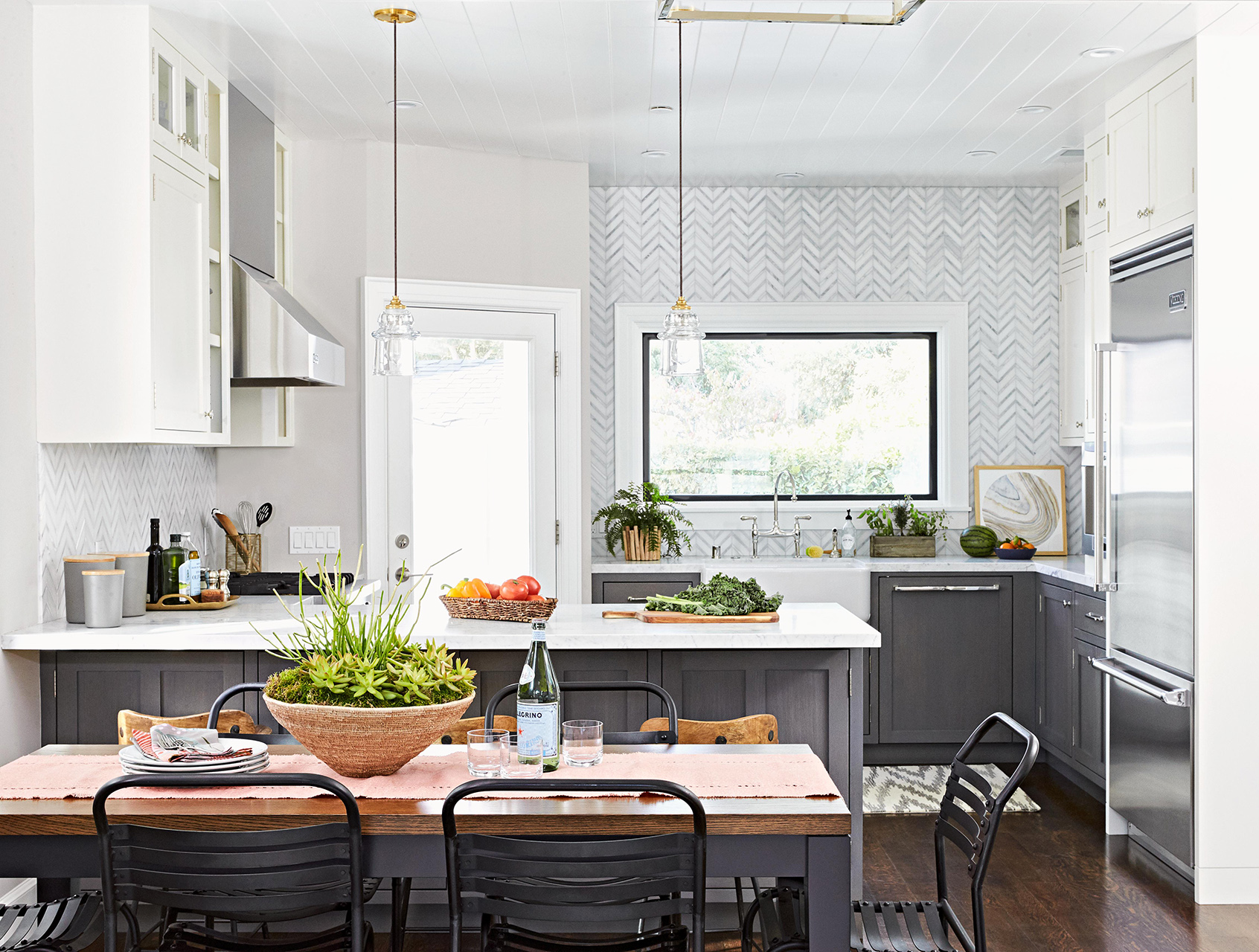 kitchen gray cabinets with dining table