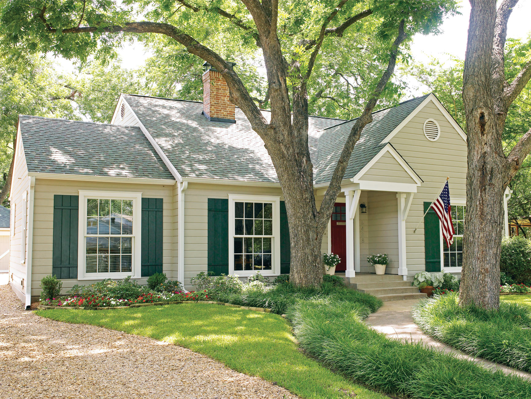 light neutral-colored ranch exterior green shutters