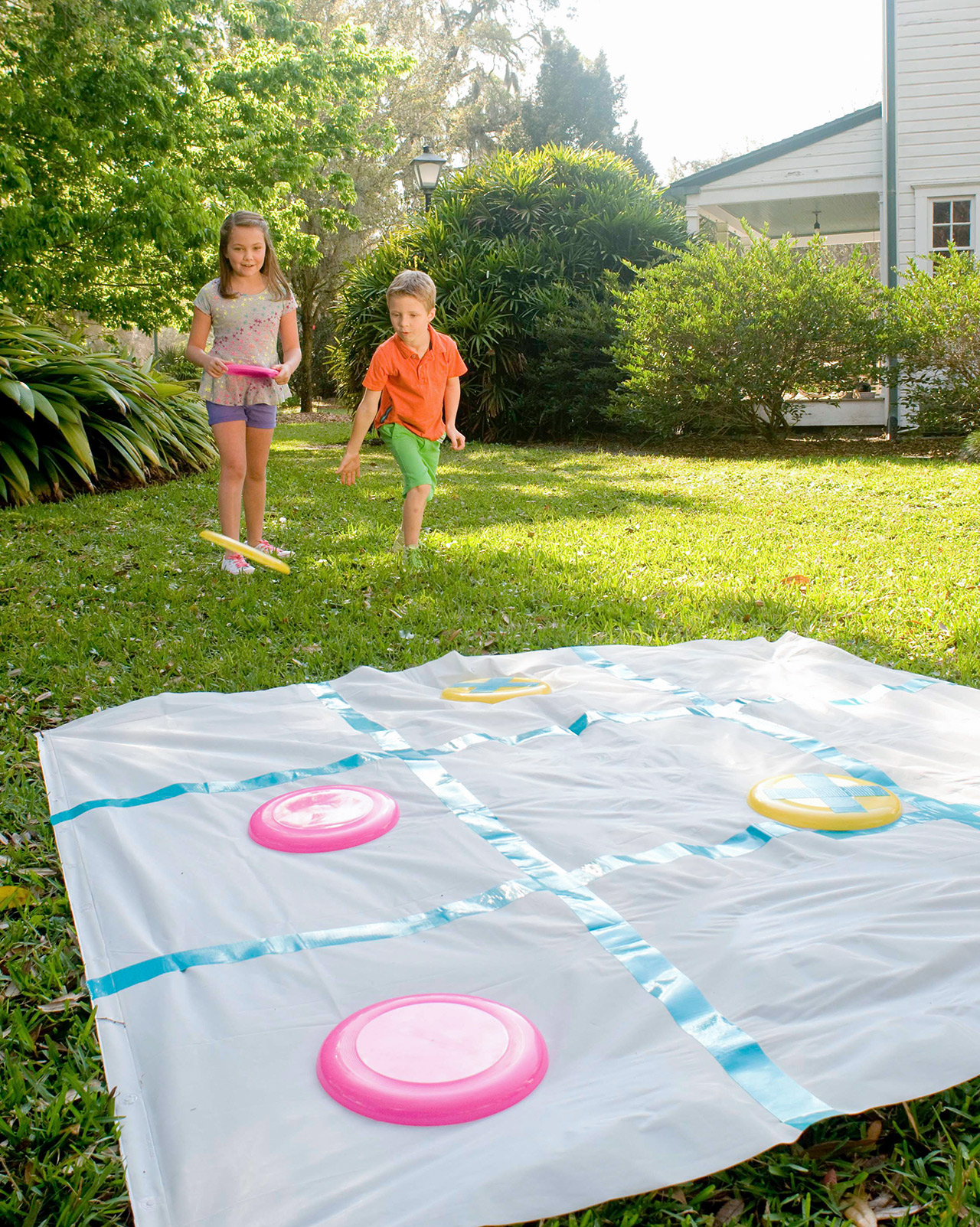kids playing disc tic-tac-toe outdoors