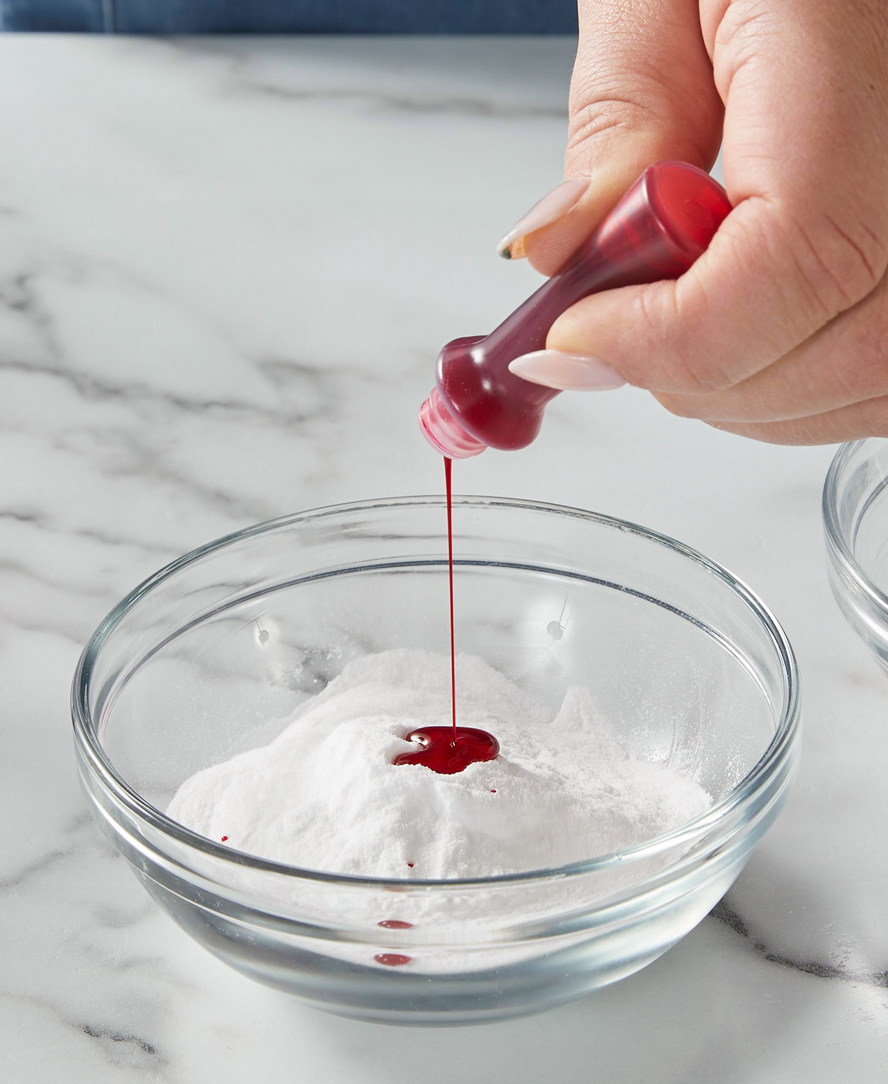 adding red coloring baking soda glass bowl