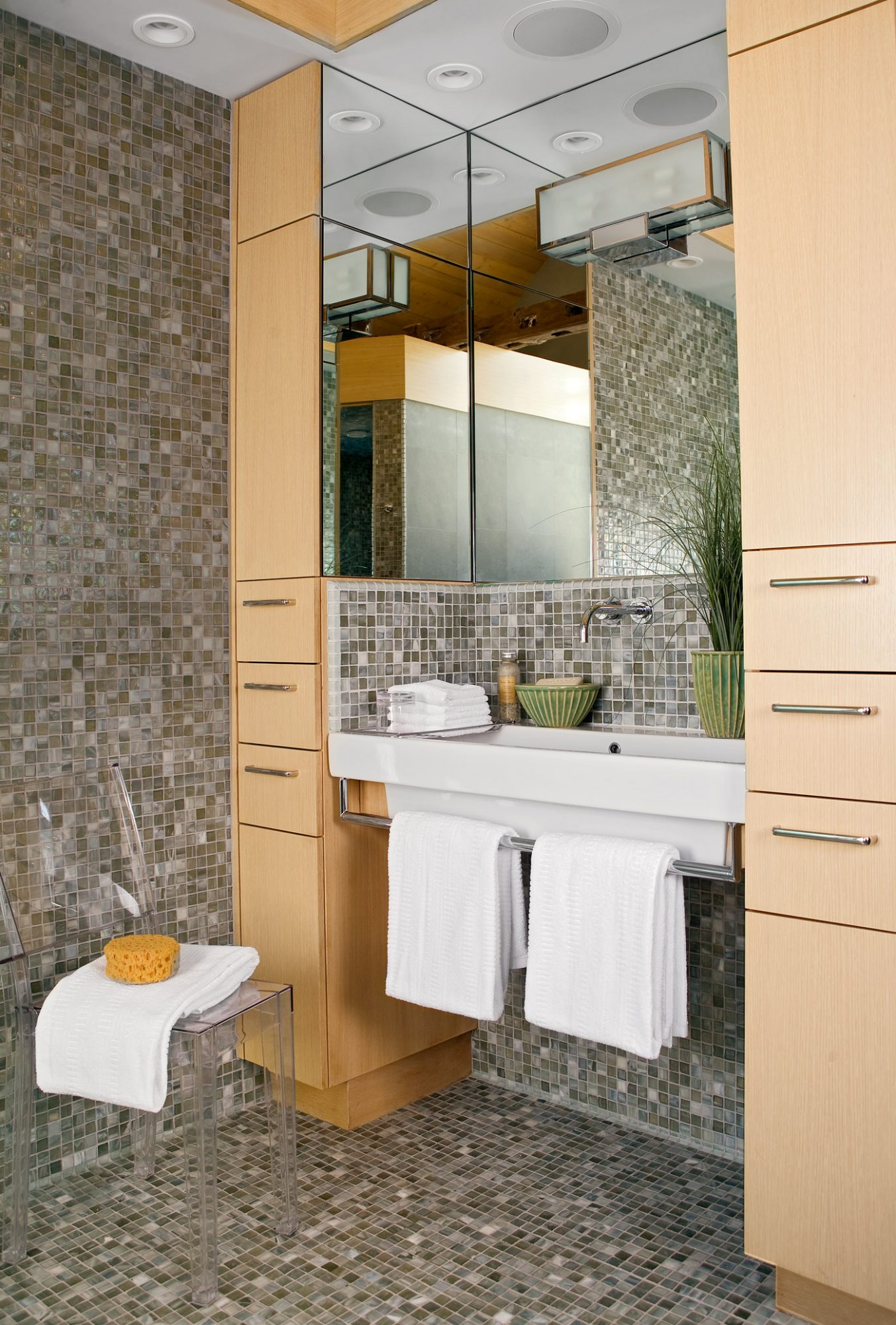 neutral-colored square-tile bathroom with narrow wood cabinets