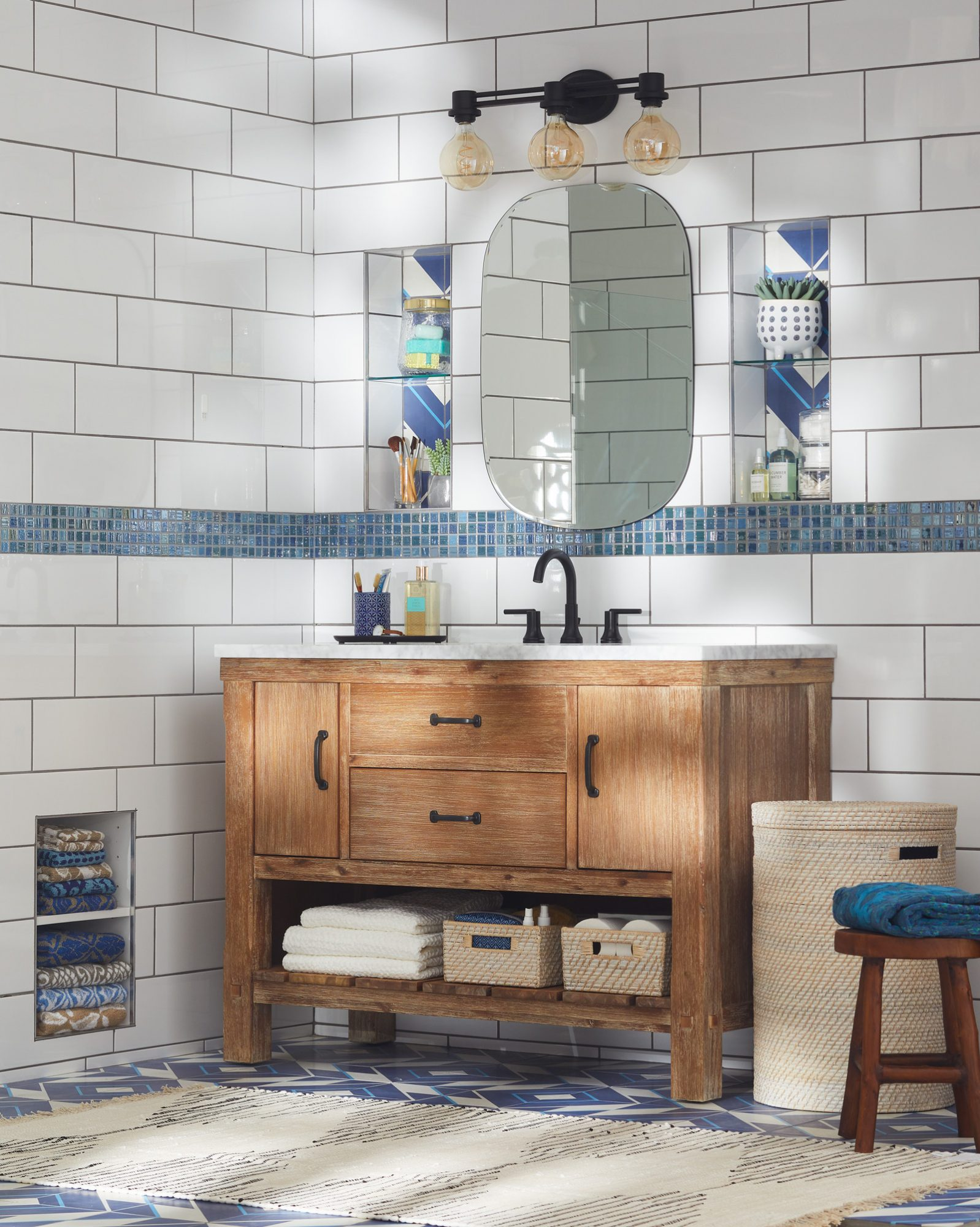 white subway tile bathroom with wooden vanity