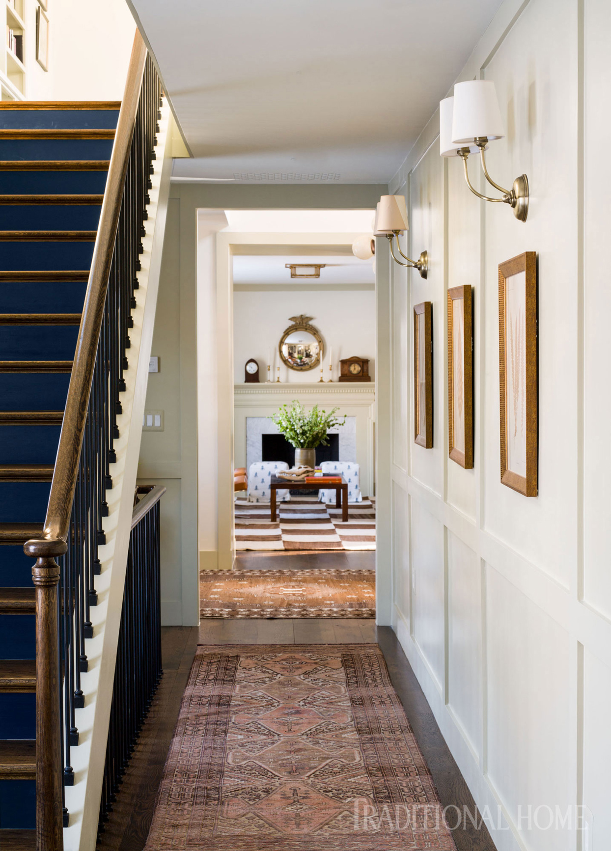 Navy staircase with wood banister