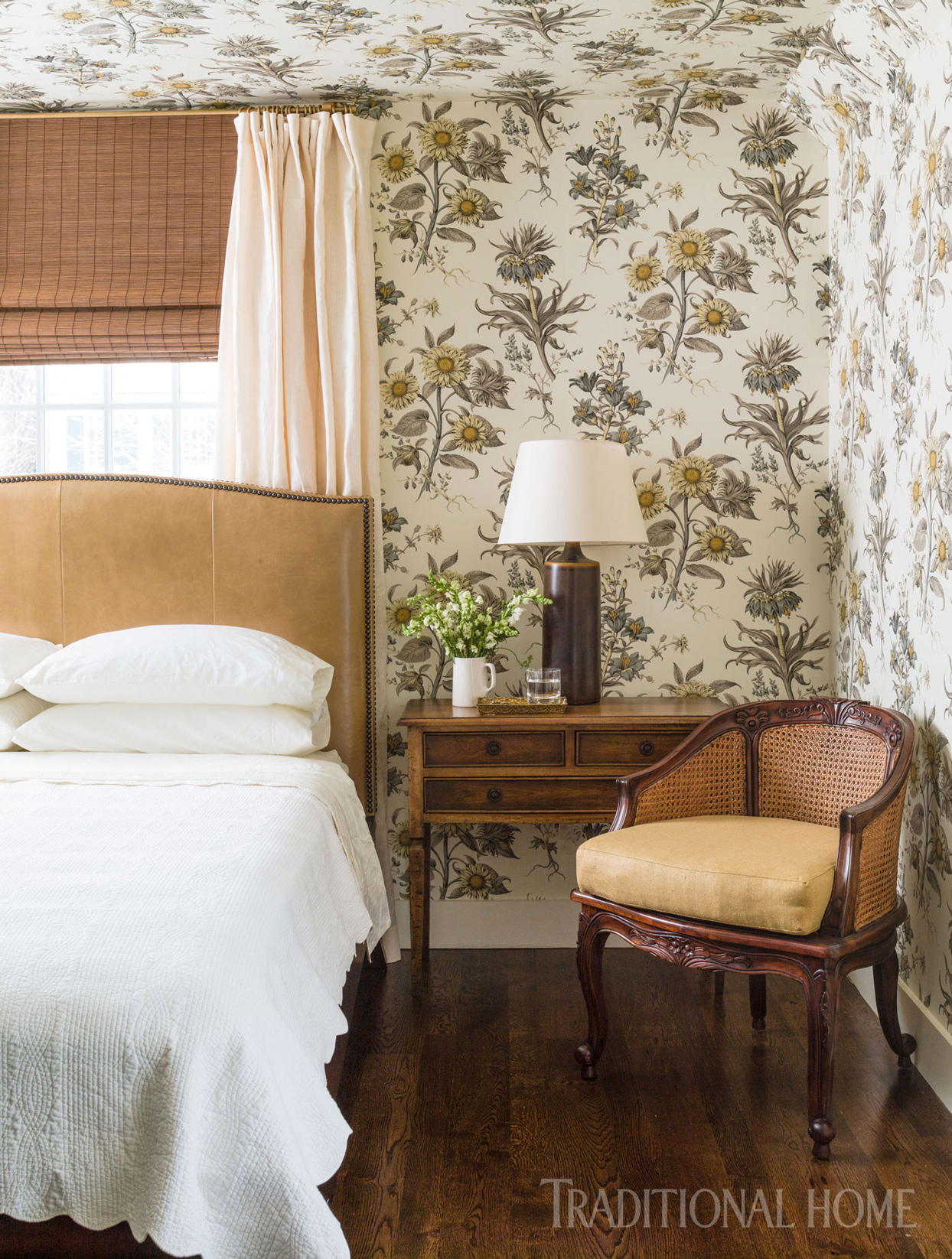 guest room with sunflower-print wallpaper