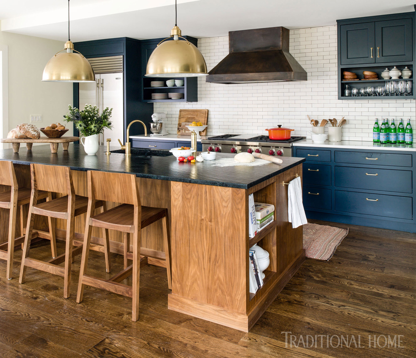kitchen with blue cabinets and white subway tile