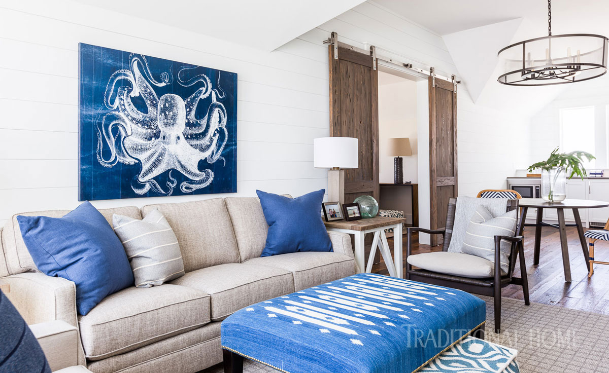 sitting area with blue ottoman