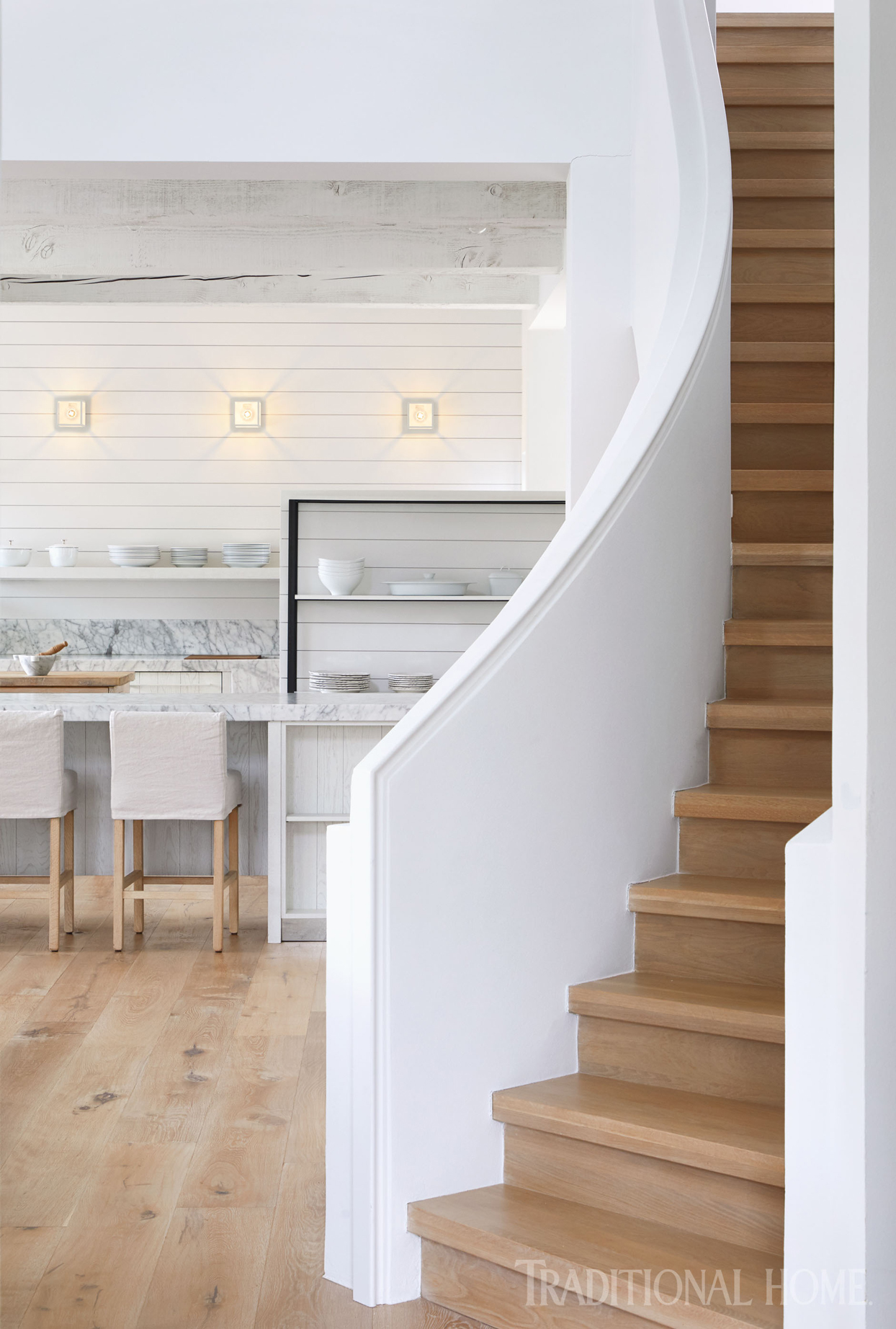 winding stairway with white walls