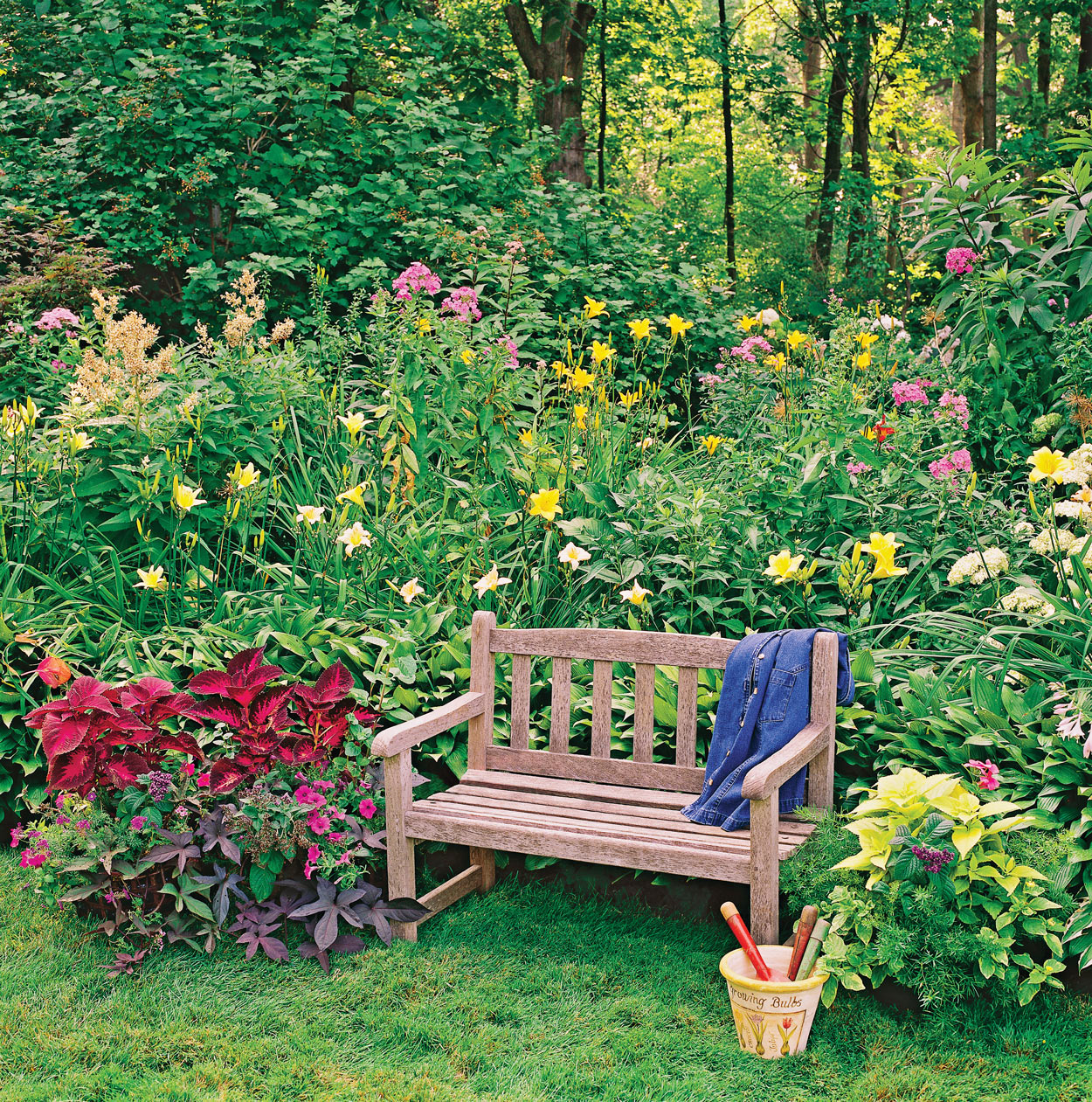 wood garden bench among plants