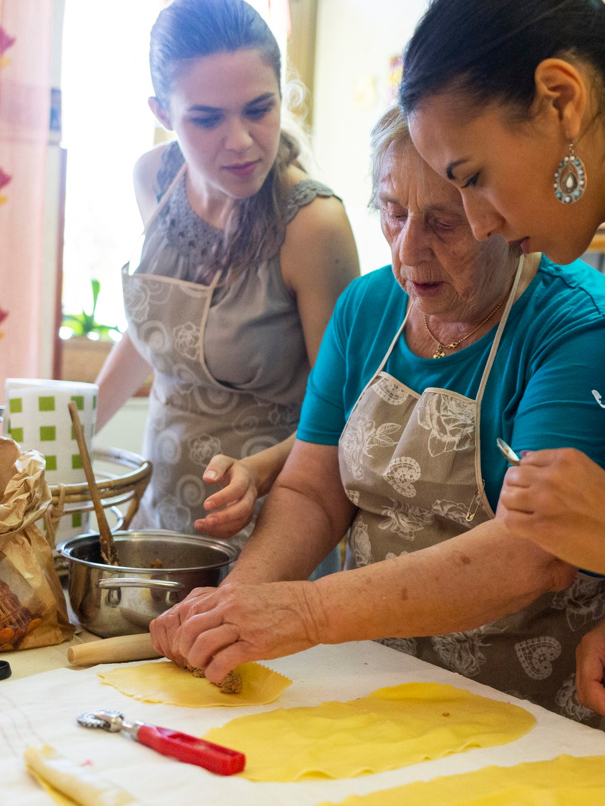 grandma teaching people to make pasta