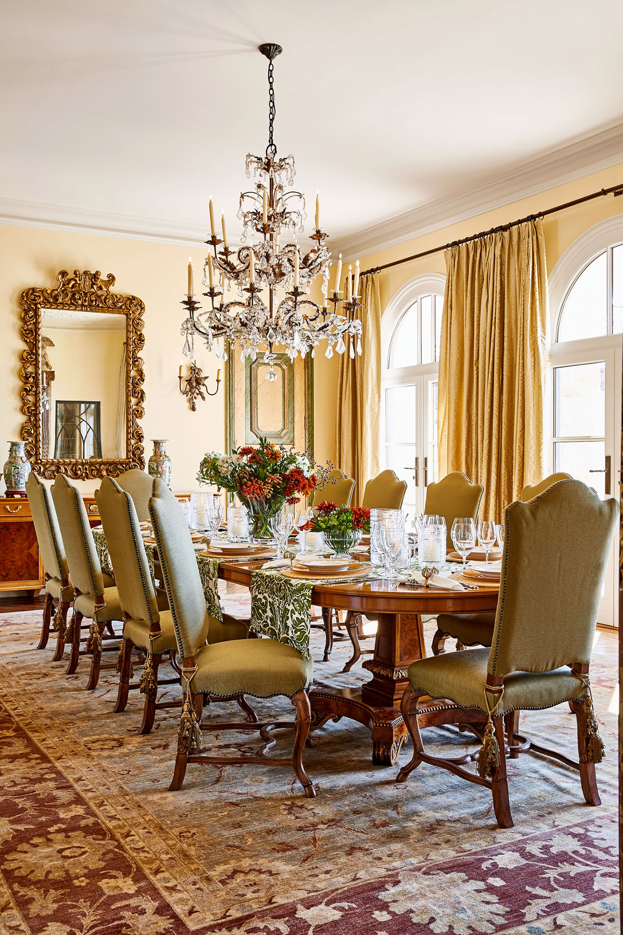 tuscan-inspired dining room with chandelier