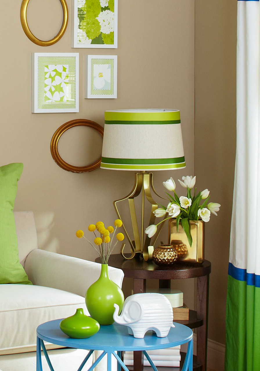green accent room with love seat and whicker chairs