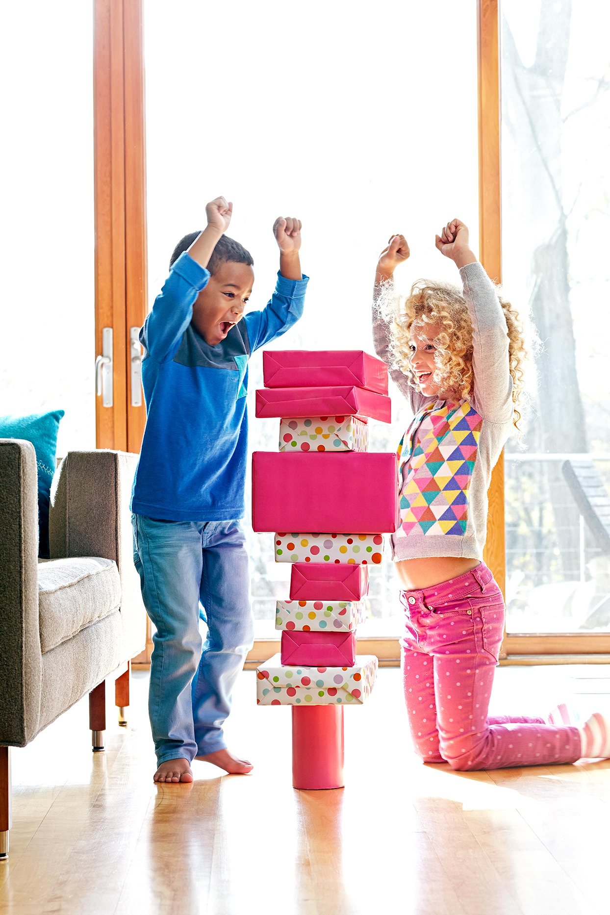 Two children stacking boxes