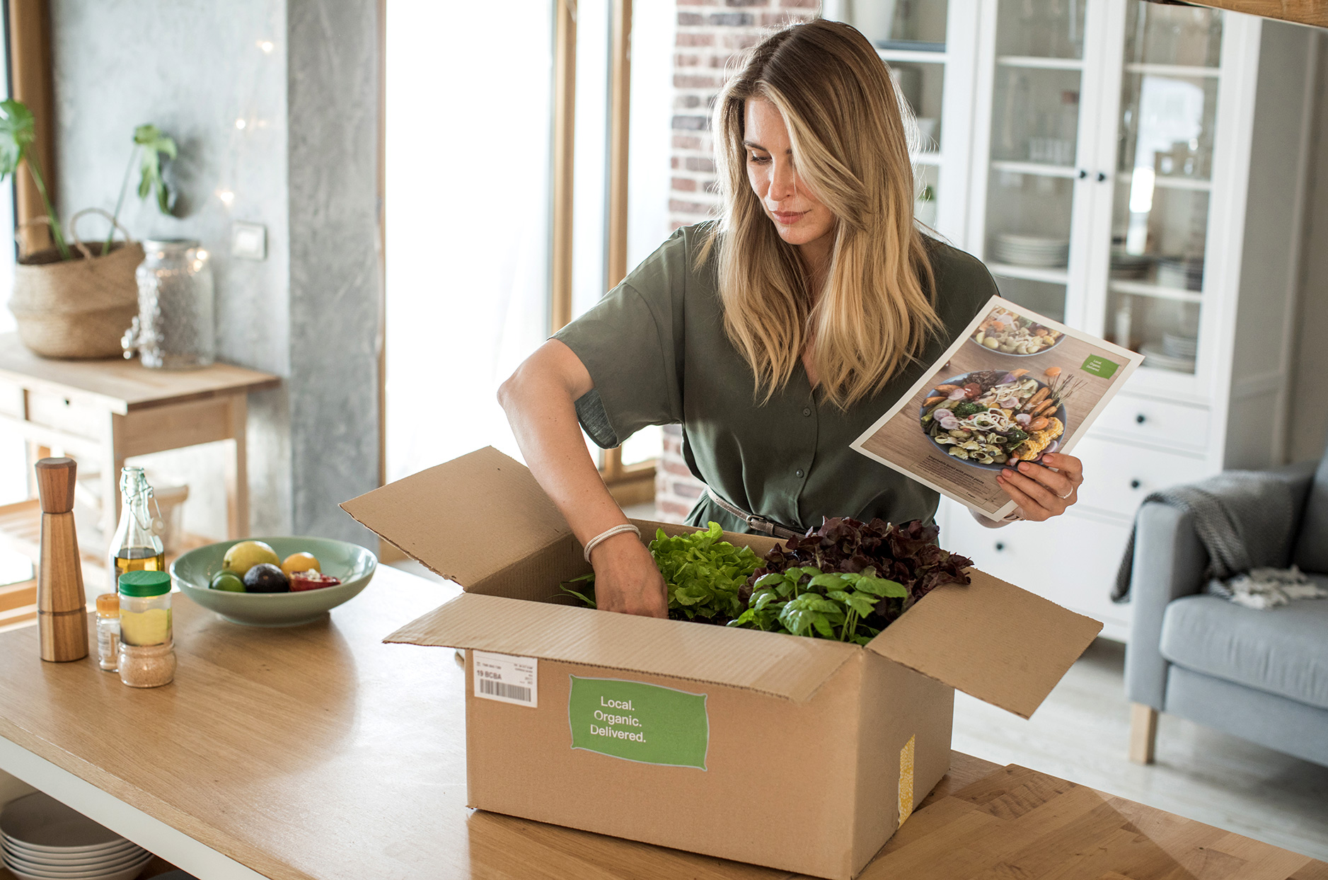 woman cooking with subscription box service