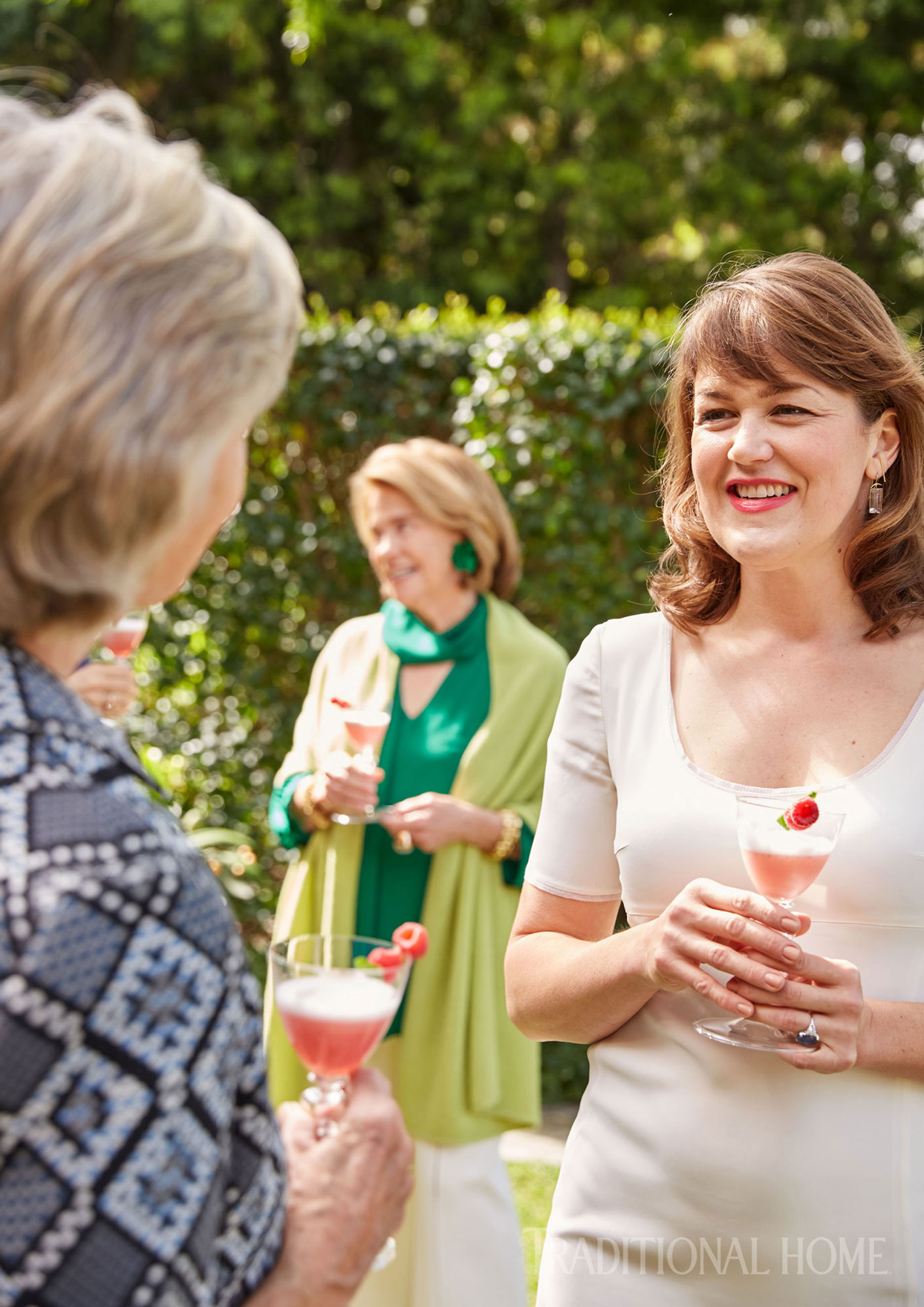 mingling guests with cocktails