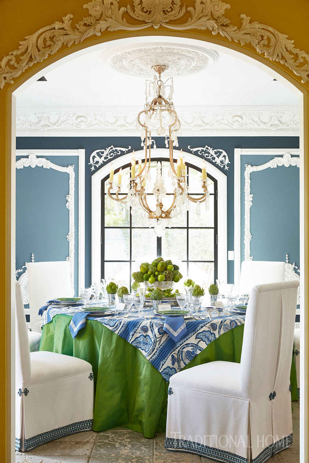 arched doorway with formal green and blue spring table