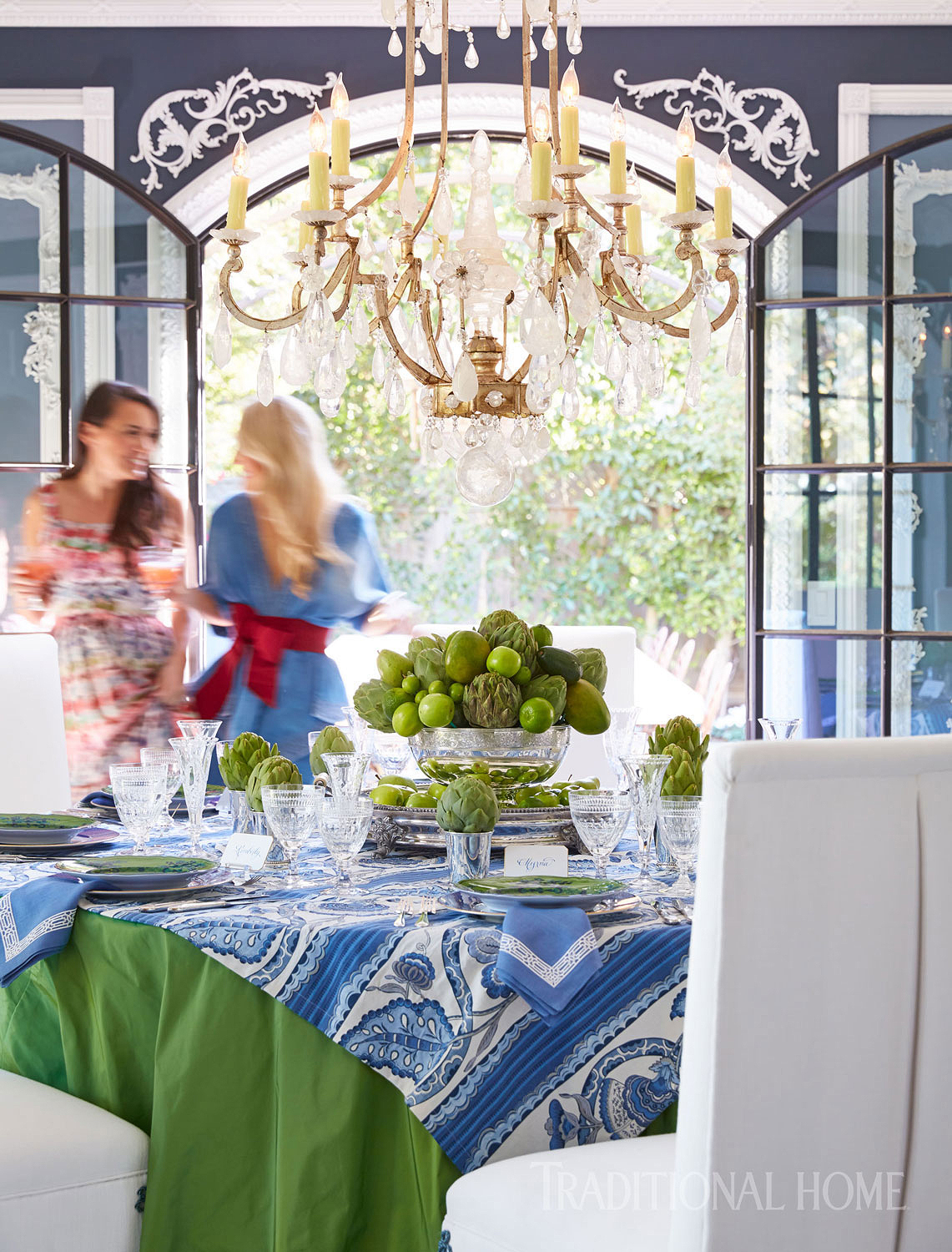 green and blue spring tablescape with women in background