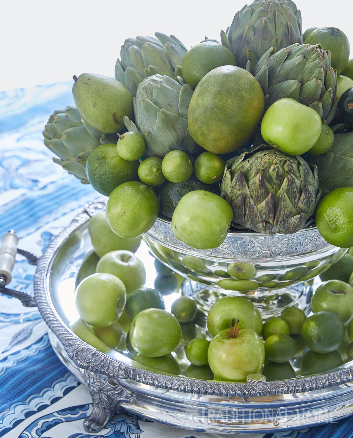 green centerpiece with artichokes, pears, apples, limes and avocado