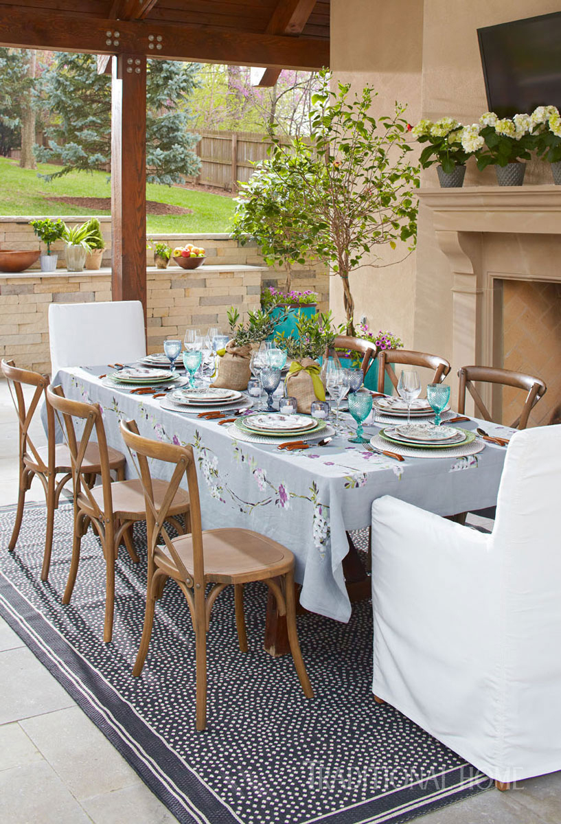 outdoor dining pavillion with dotted rug