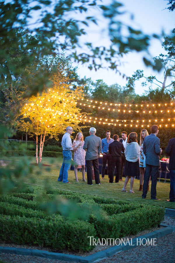 outdoor guests under strings of lights