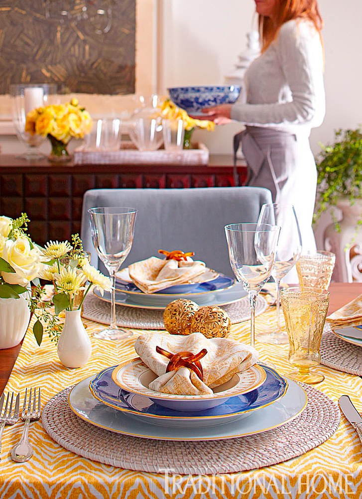 set table with yellow daisies
