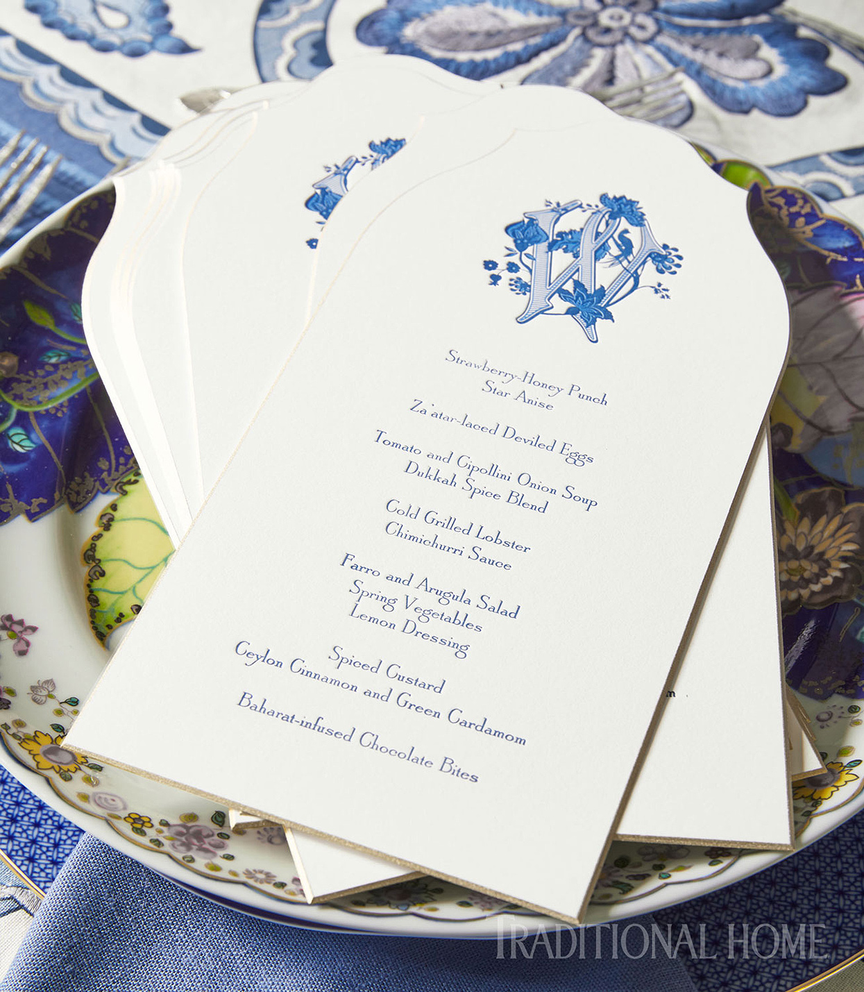 traditional menus with blue monogram on plate