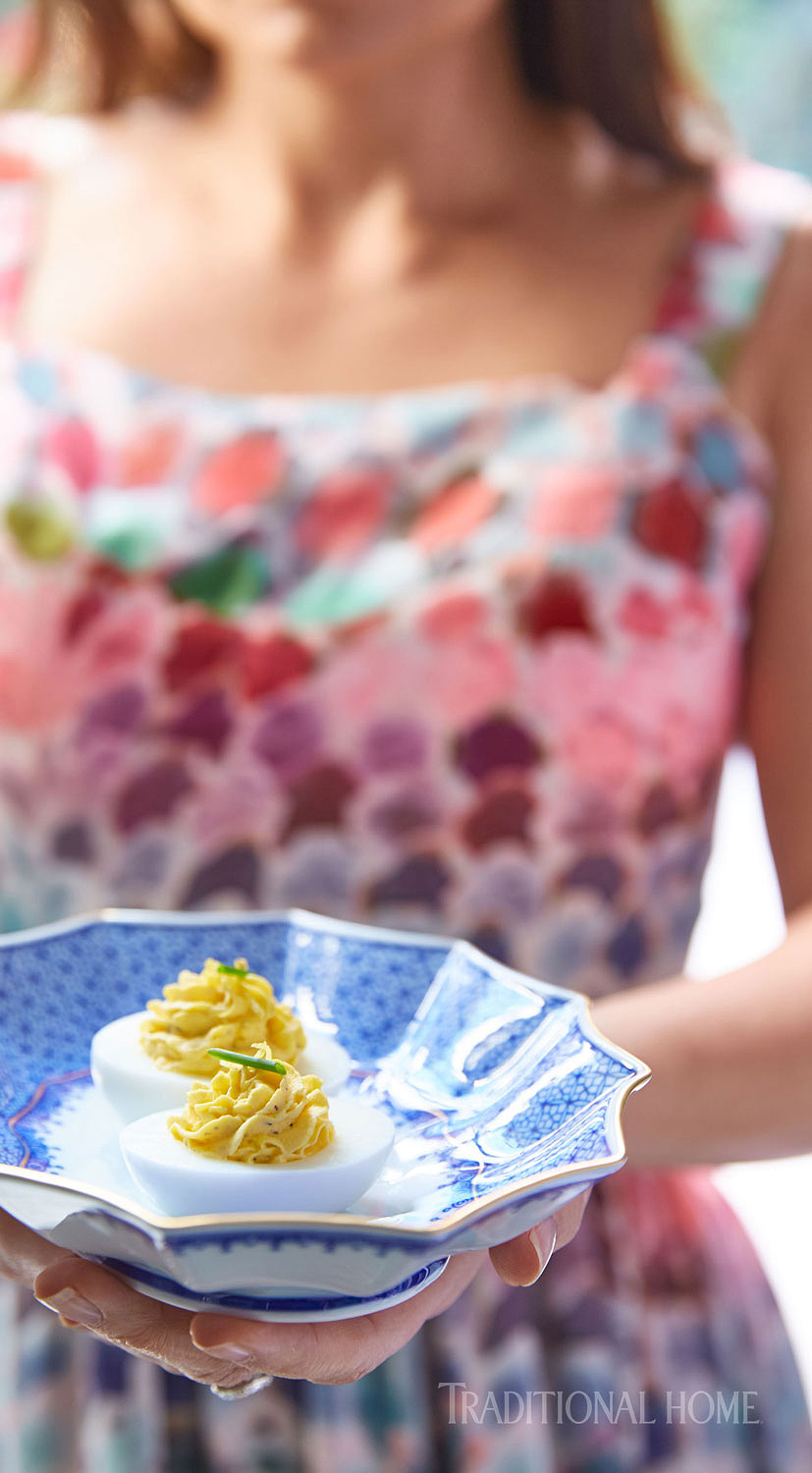 woman holding bowl with za'atar-laced deviled eggs