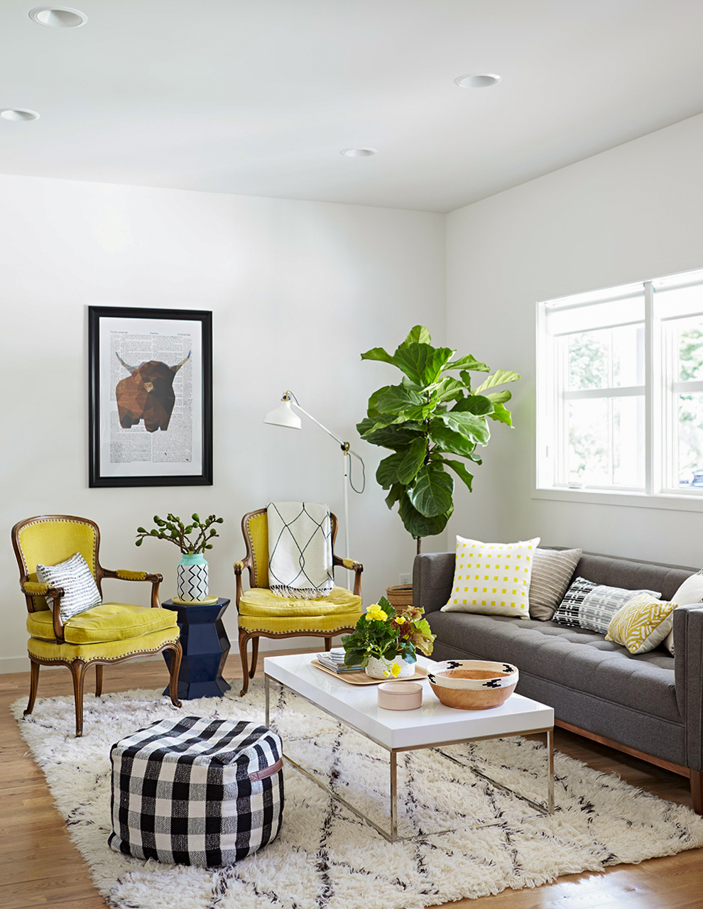 white living room with traditional chartreuse armchairs