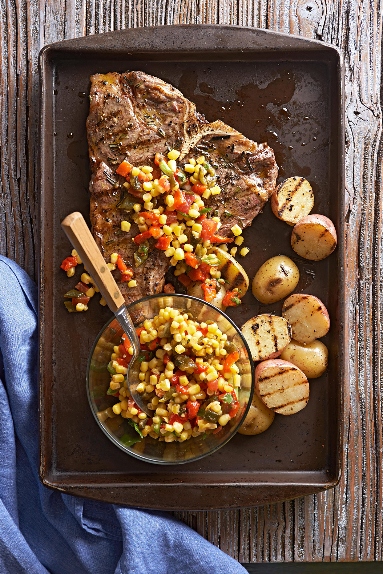 Corn and Roasted Pepper Relish in bowl and on steak