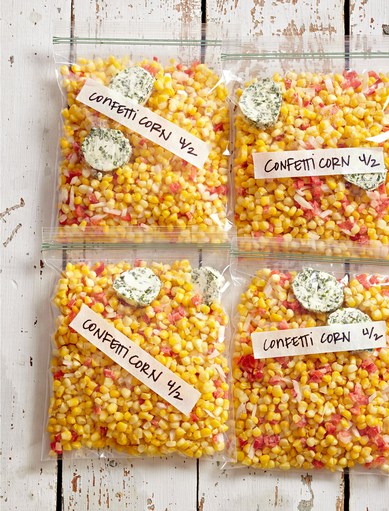 four labeled bags of freezer confetti corn