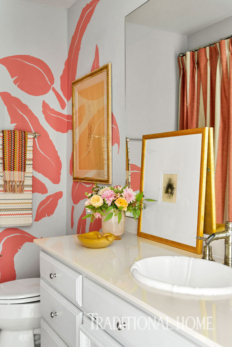 guest bathroom with pink banana leaves on walls