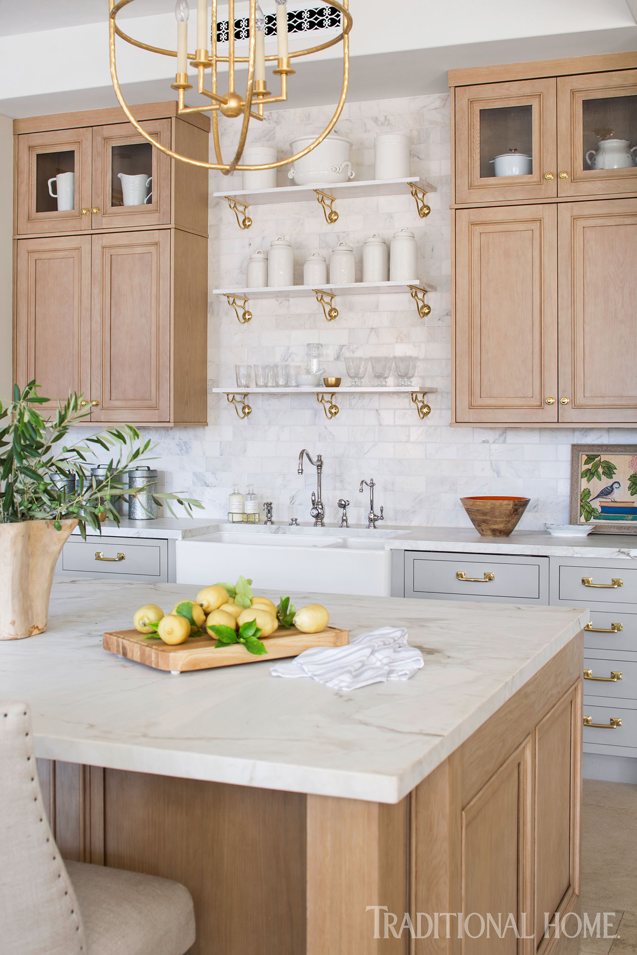 Kitchen with marble backsplash and counter