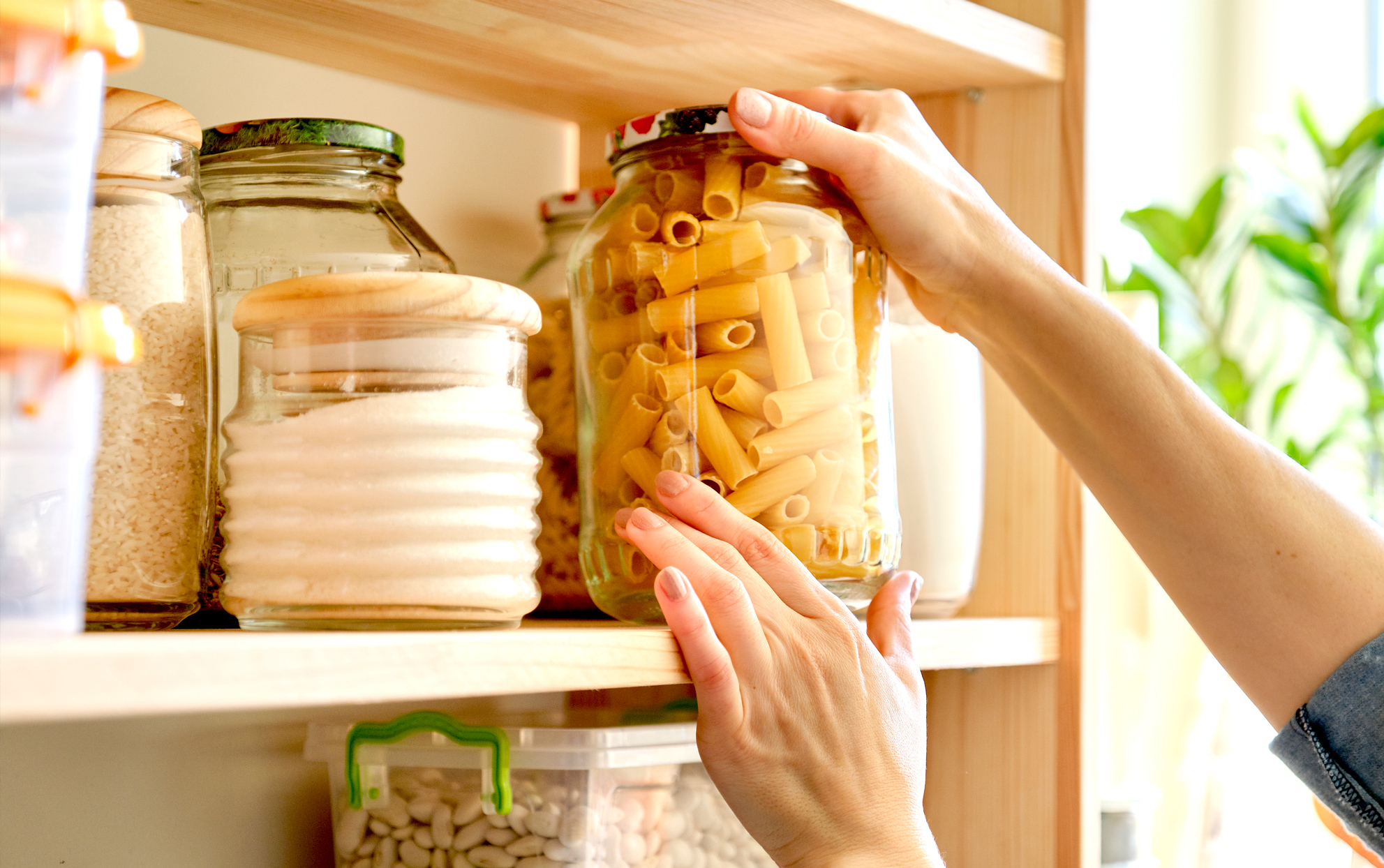 close up of a woman stocking a pantry