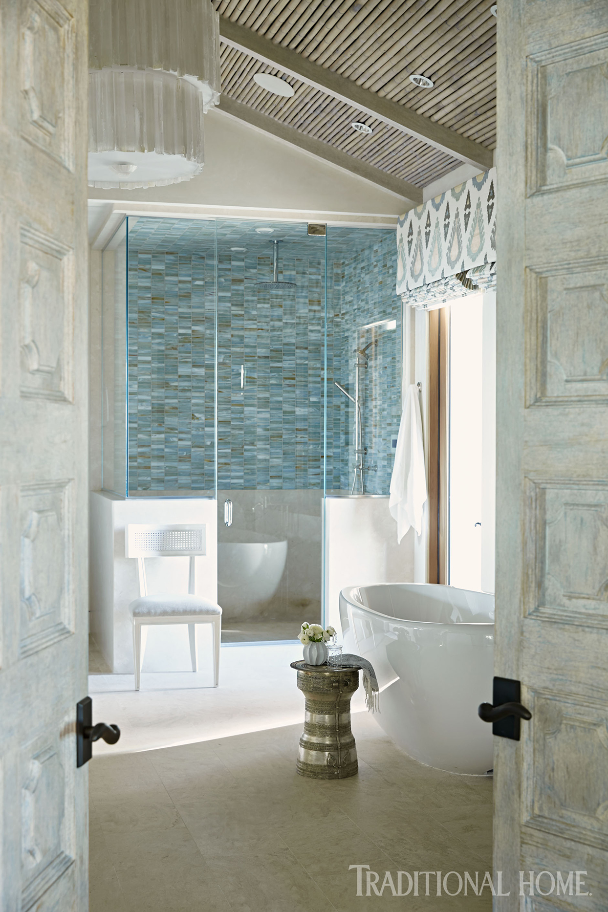 Bathroom with blue tile and white bathtub