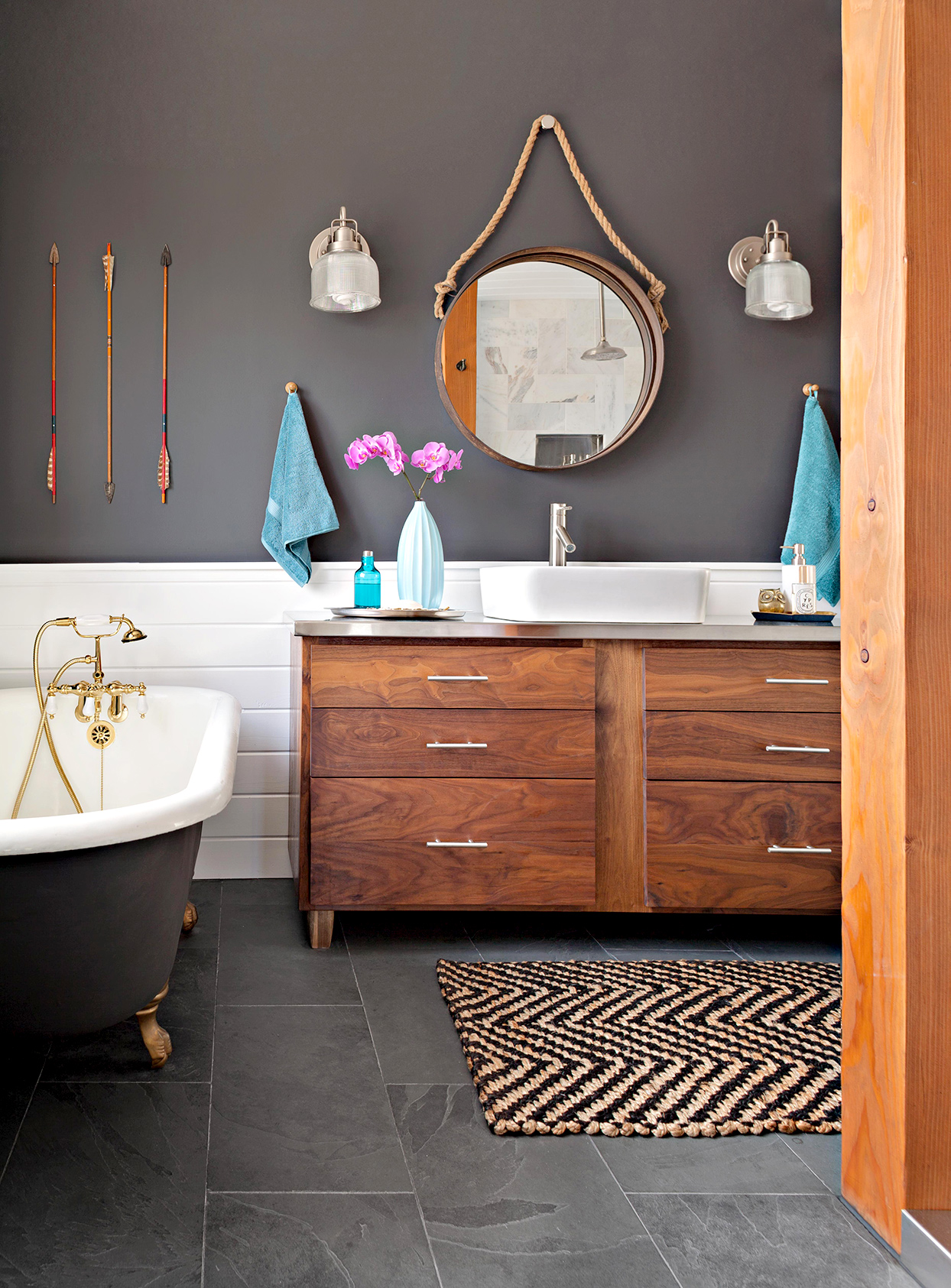 Bathroom with dark walls and wooden cabinets