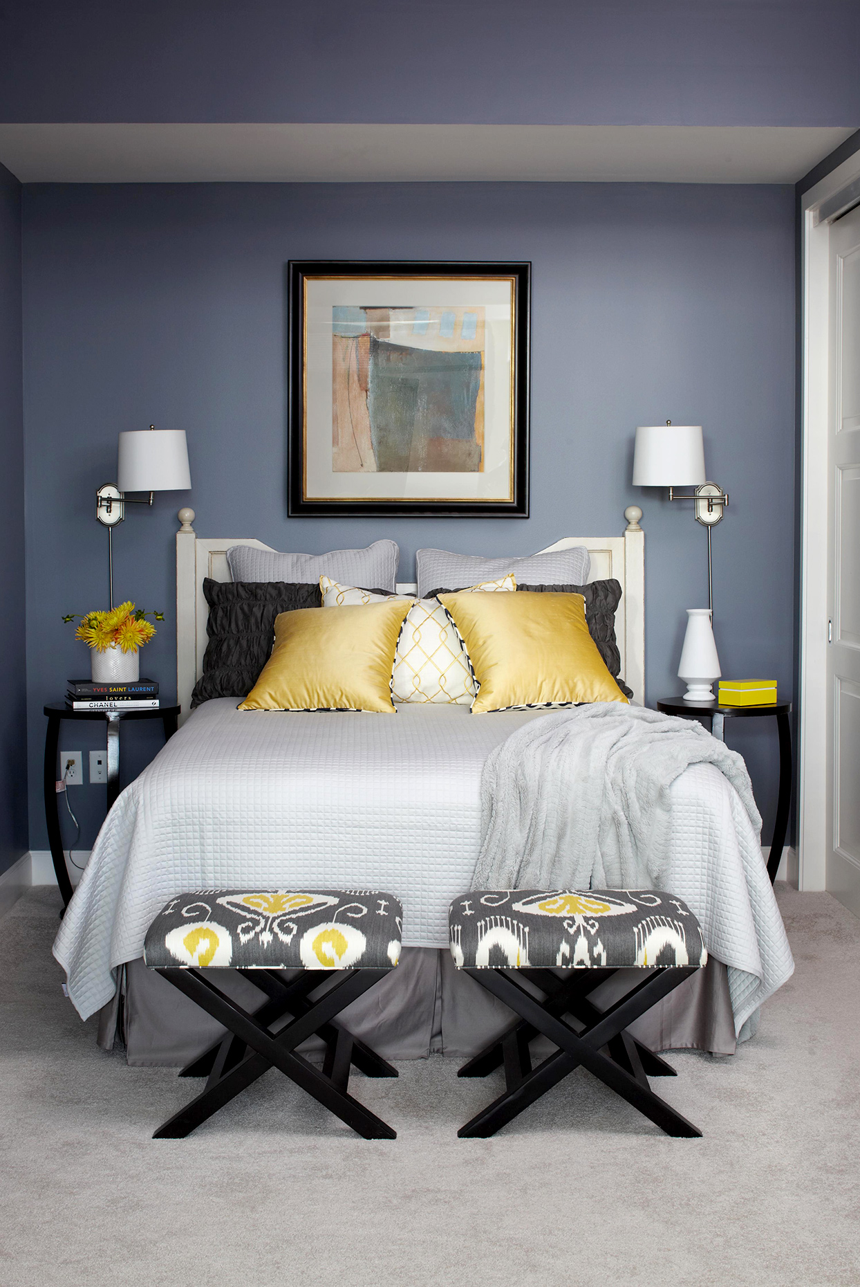 Bedroom with dark gray walls and gold and blue accents
