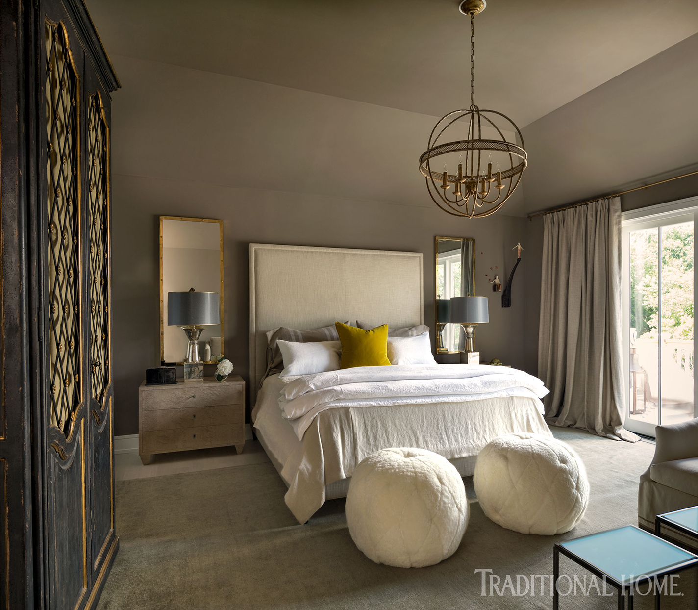 Bedroom with dark gray walls and ottomans
