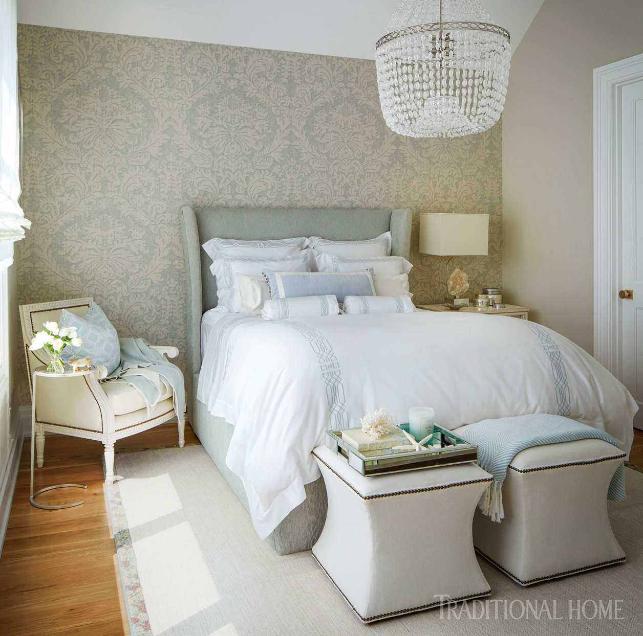 bedroom with muted tones and chandelier