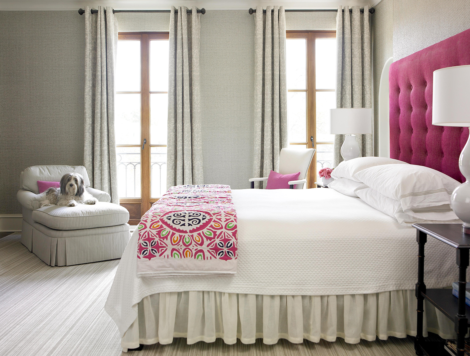 Bedroom with pink and white décor and gray textured walls