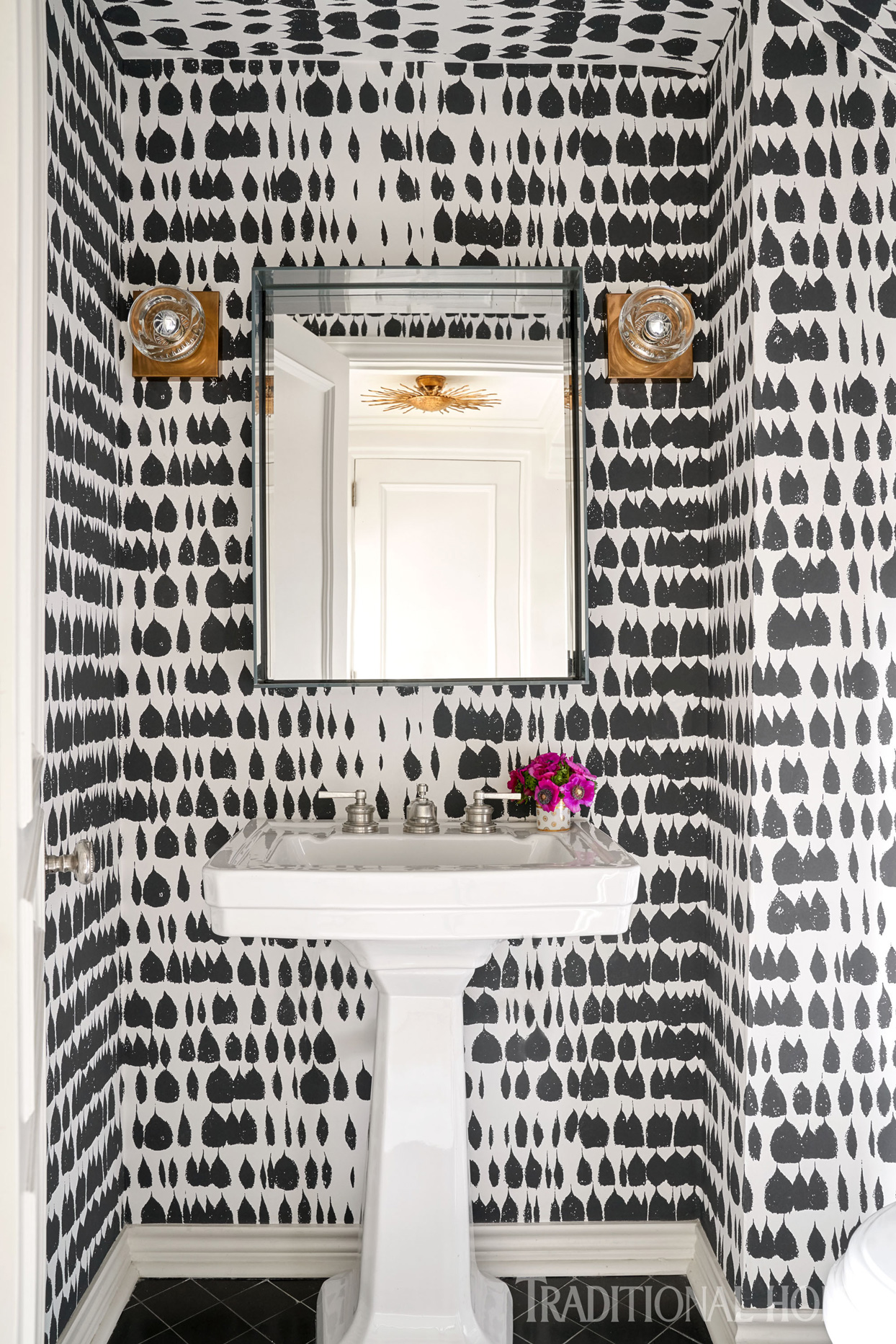 black teardrop shaped wallpaper in bathroom