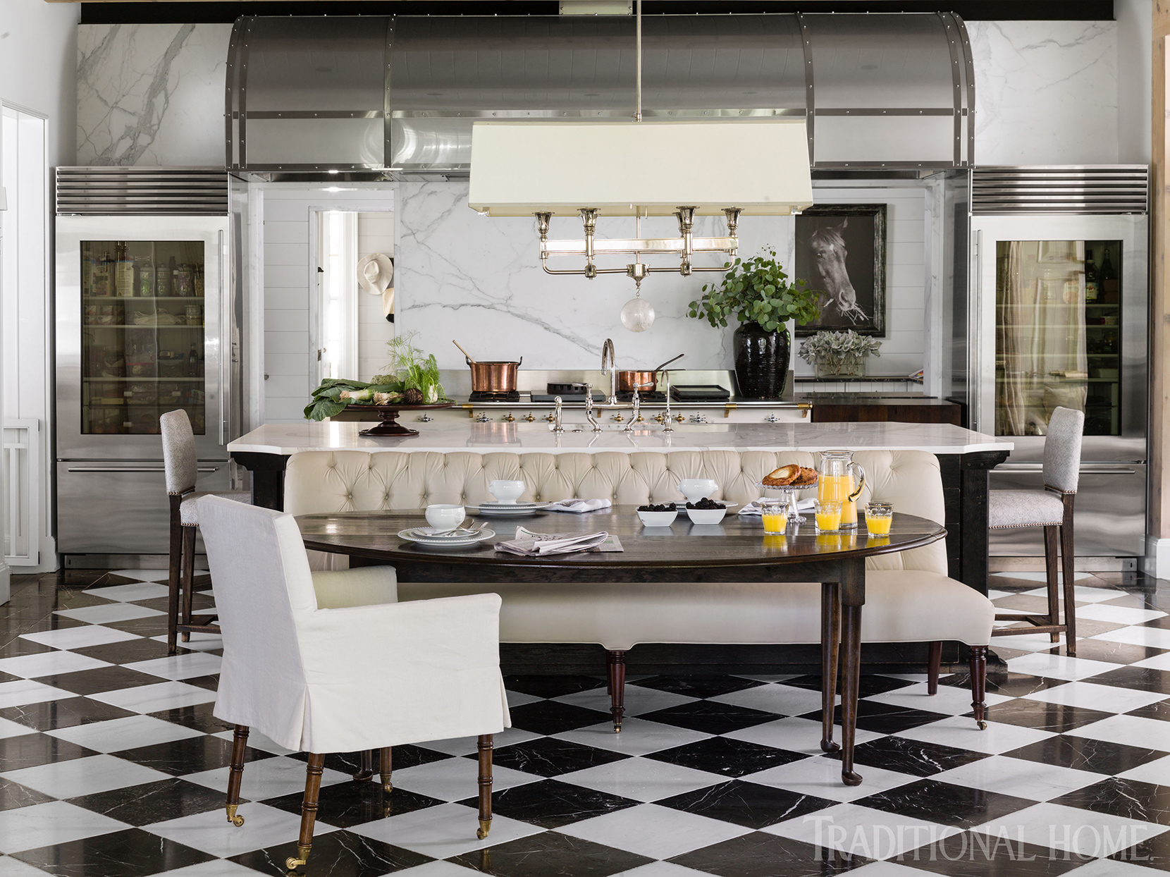 black and white kitchen with checkered floor