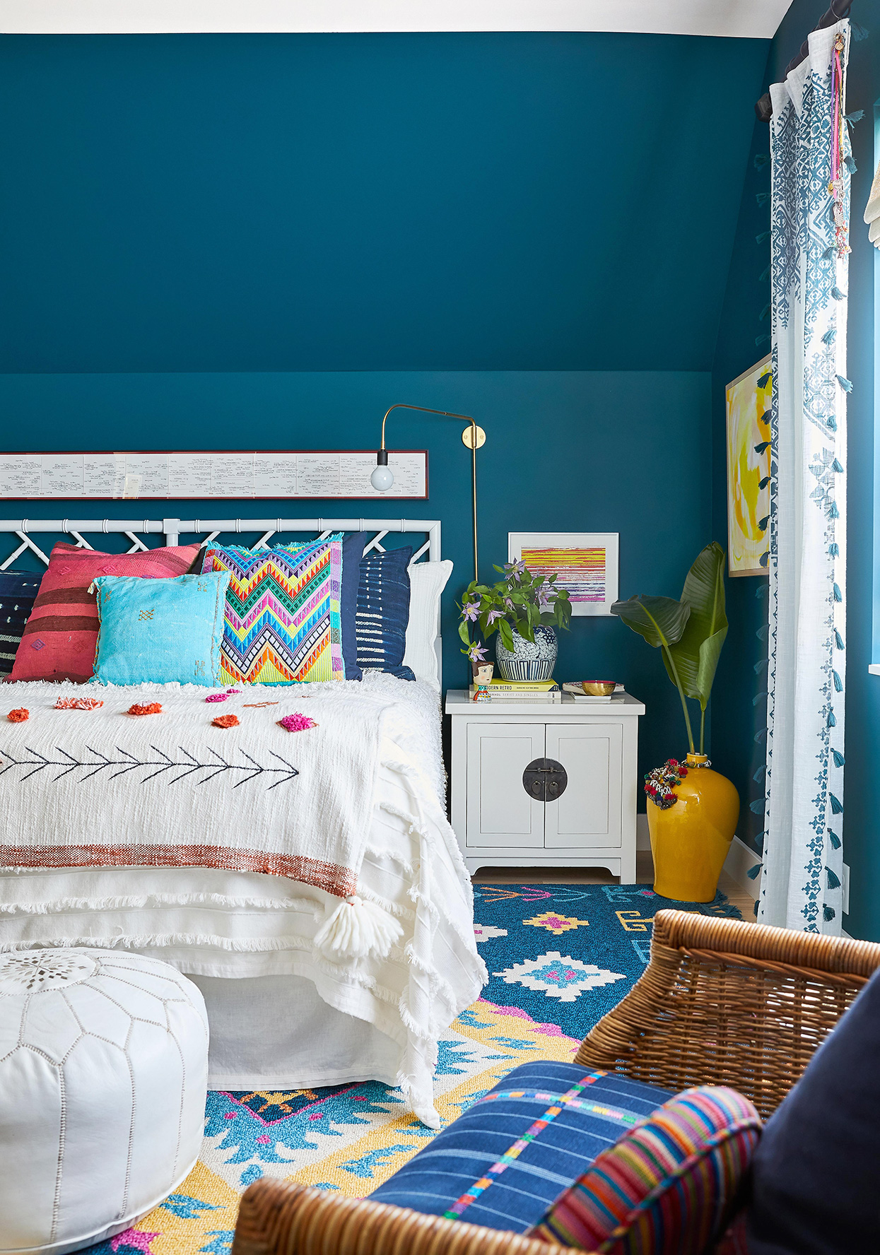 dark blue guest bedroom with moroccan-inspired colorful decor