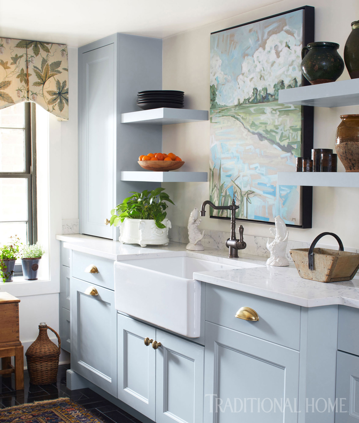 blue cabinets and sink