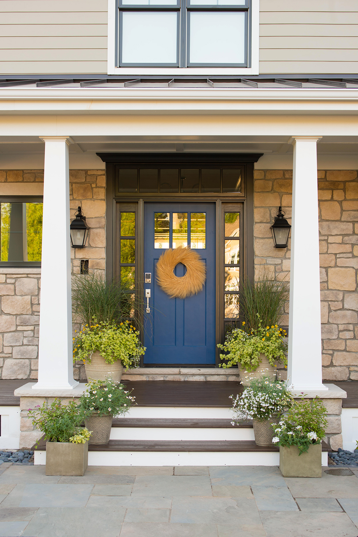 blue front door stone accents on house