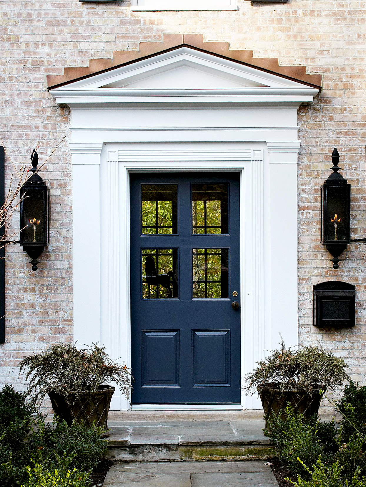 Blue front door with white trim