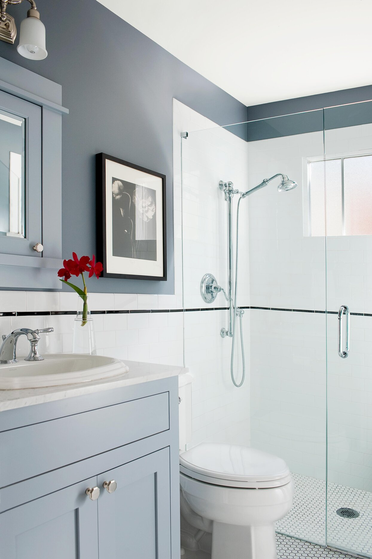 blue-gray bathroom with red flowers