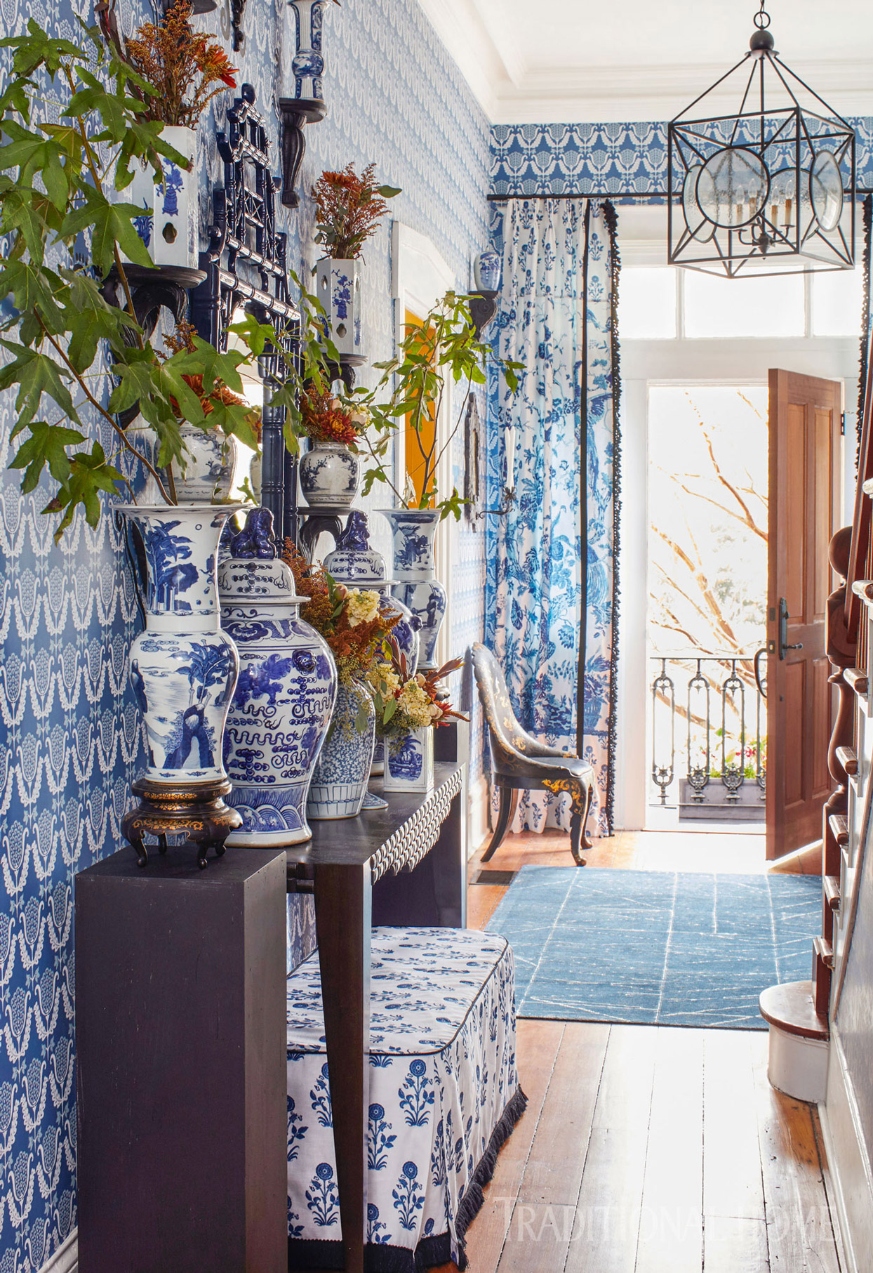 blue and white entryway with vases